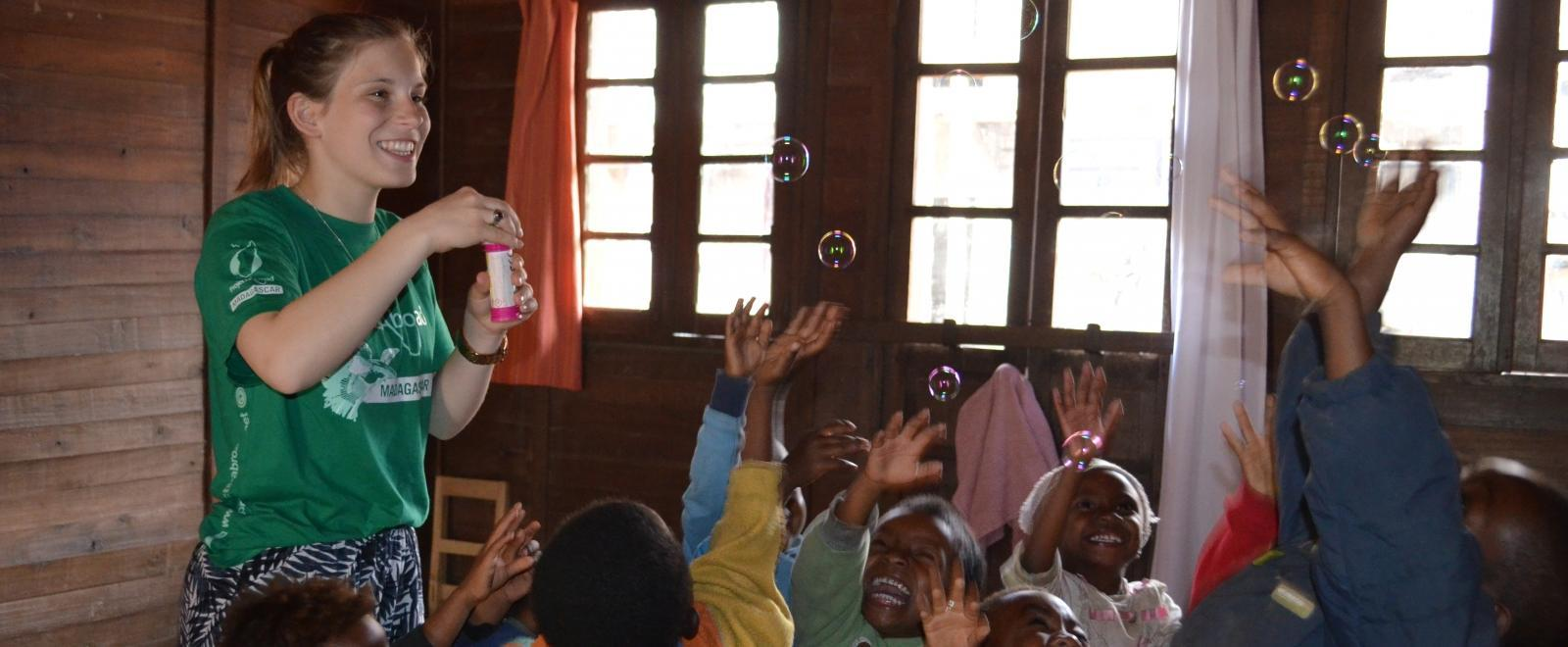 A Projects Abroad volunteer in Madagascar plays with the children after fundraising for her project.